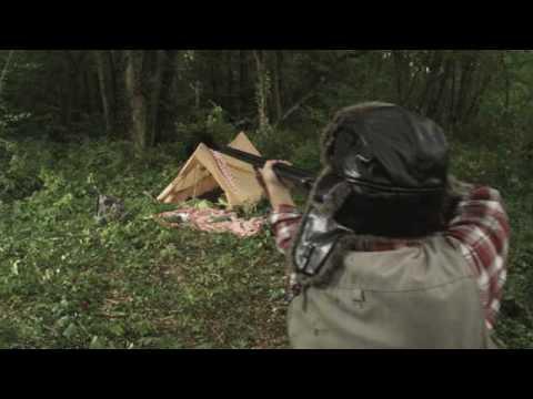 A hunter [ …     ] a bear!