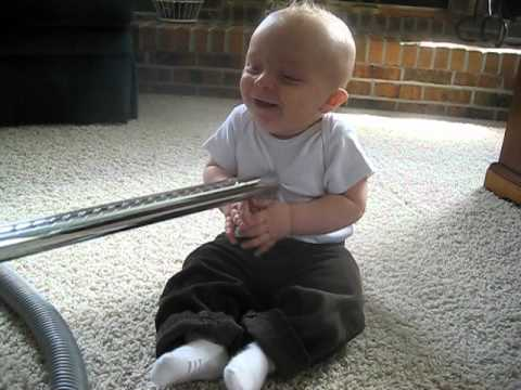 Baby thinks the vacuum is so funny!