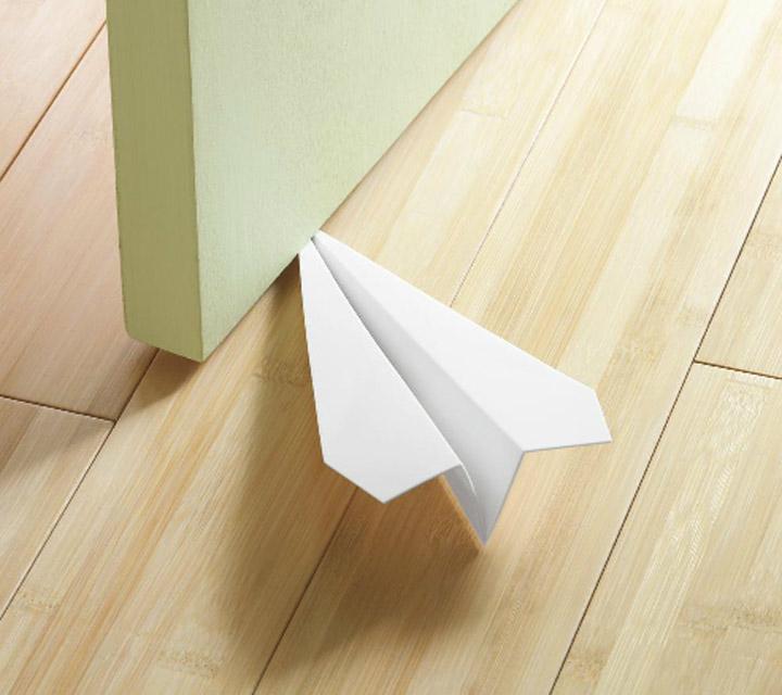 Papierfliegertürstopper