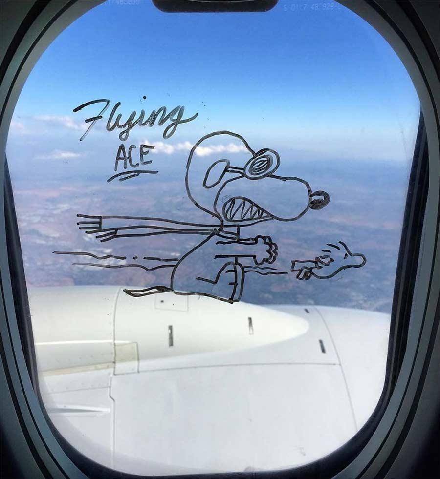 Fenstermalerei im Flugzeug
