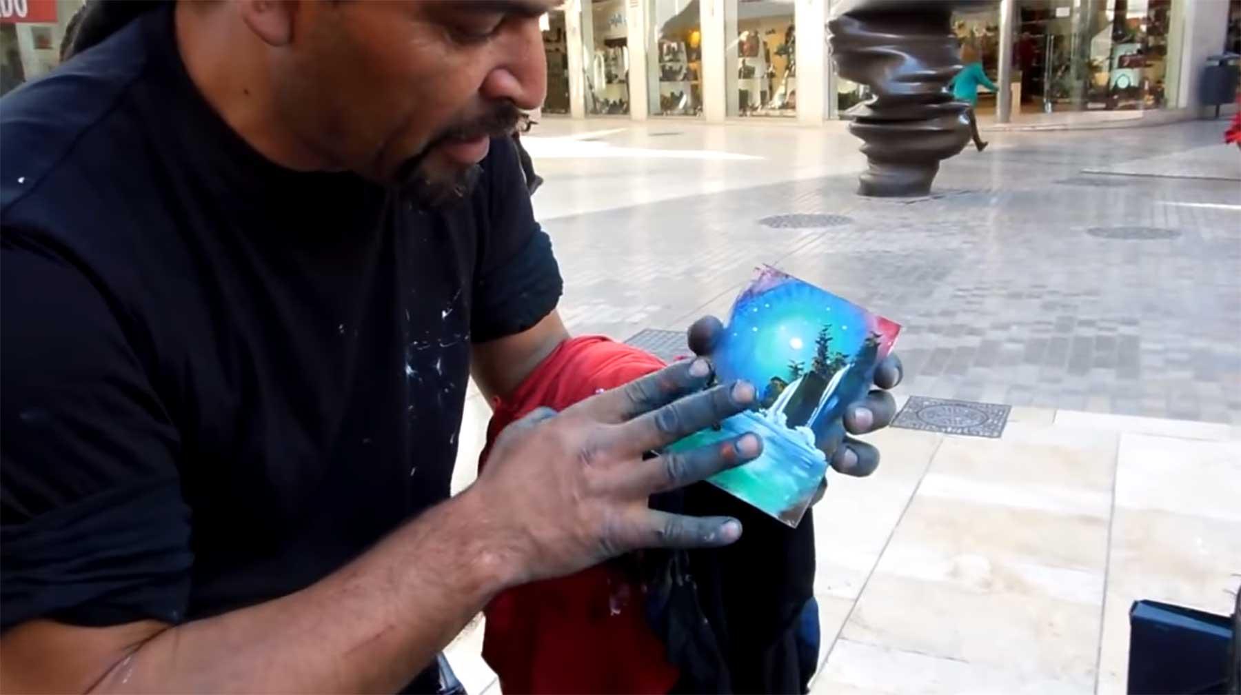 Unglaublich schneller Fingerfarb-Straßenkünstler