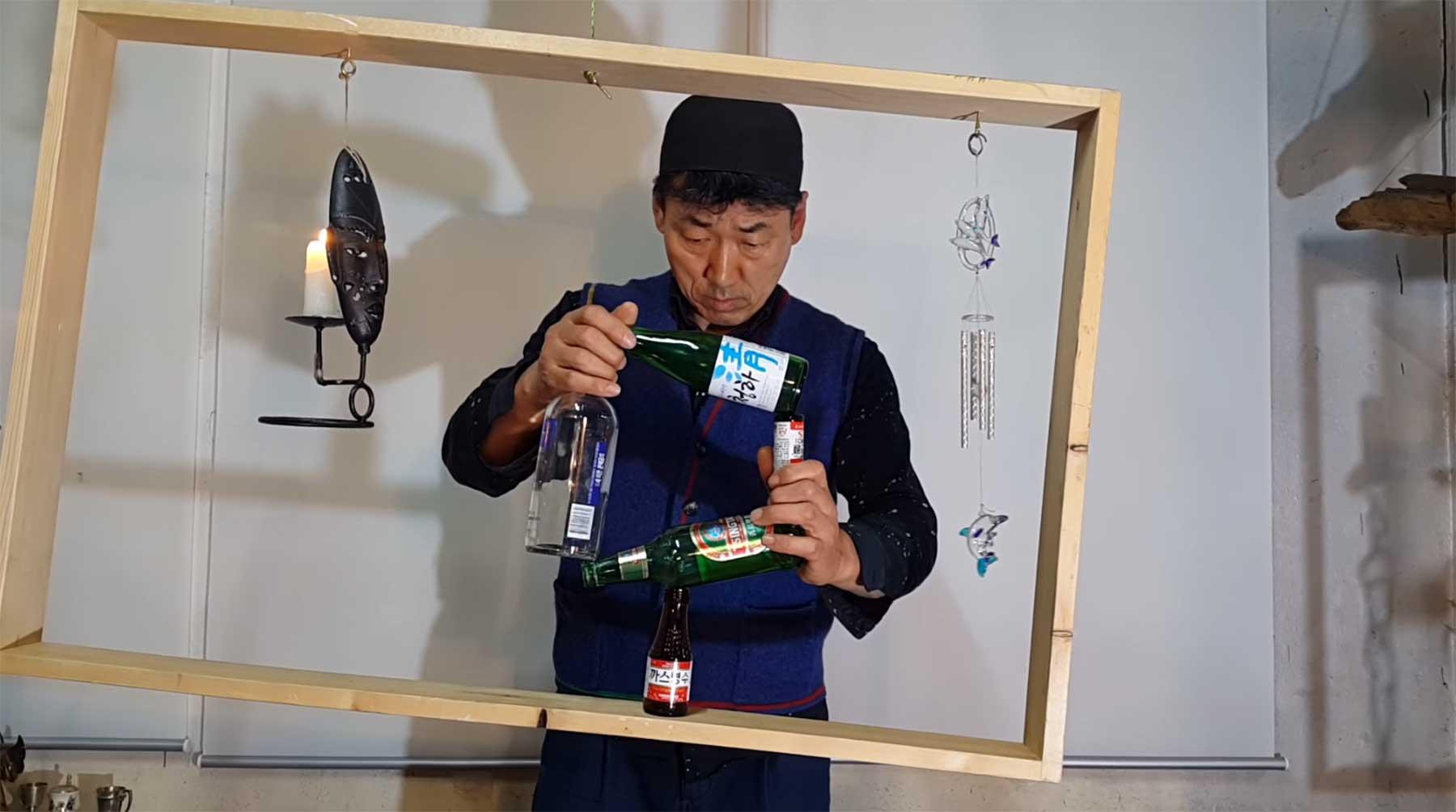 Flaschenviereck im drehängenden Rahmen ausbalancieren