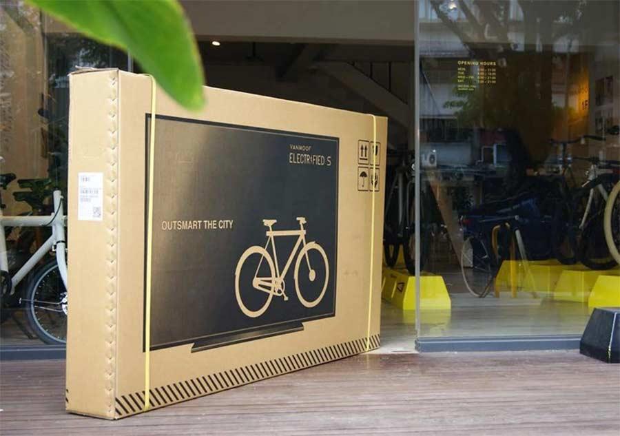 Auf Fahrrad-Pakete gedruckte Fernseher, um Transportschäden zu minimieren Vanmoof-bike-box-tv_03