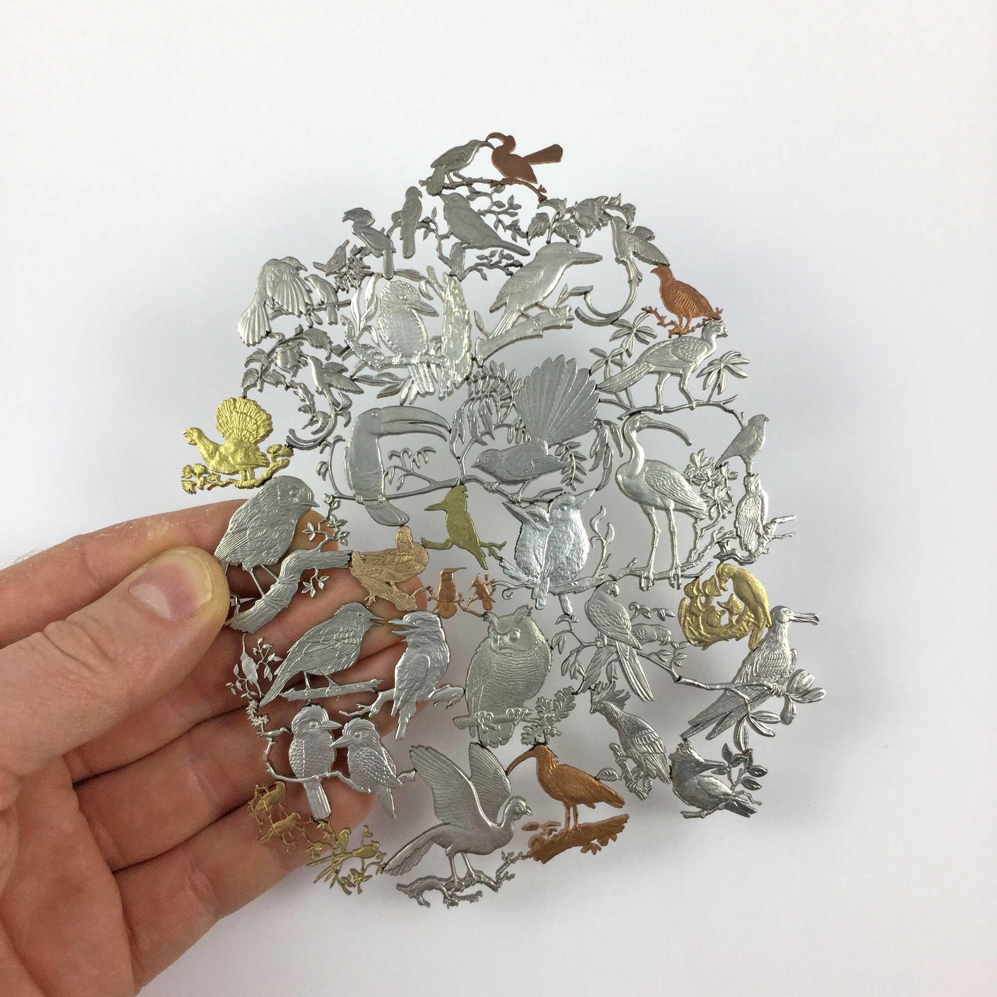 Micah Adams sägt Motive aus Münzen Micah-Adams_muenzkunst_05