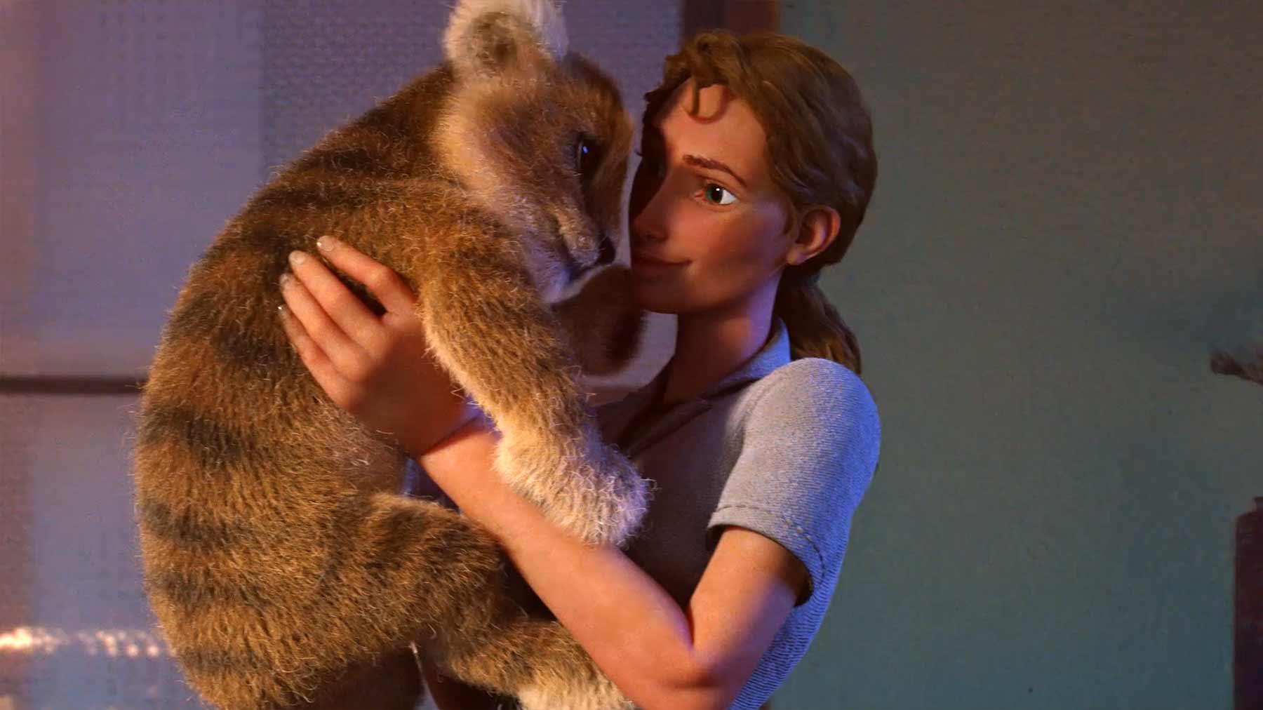 Eine Tierpflegerin und ihr Löwen-Baby