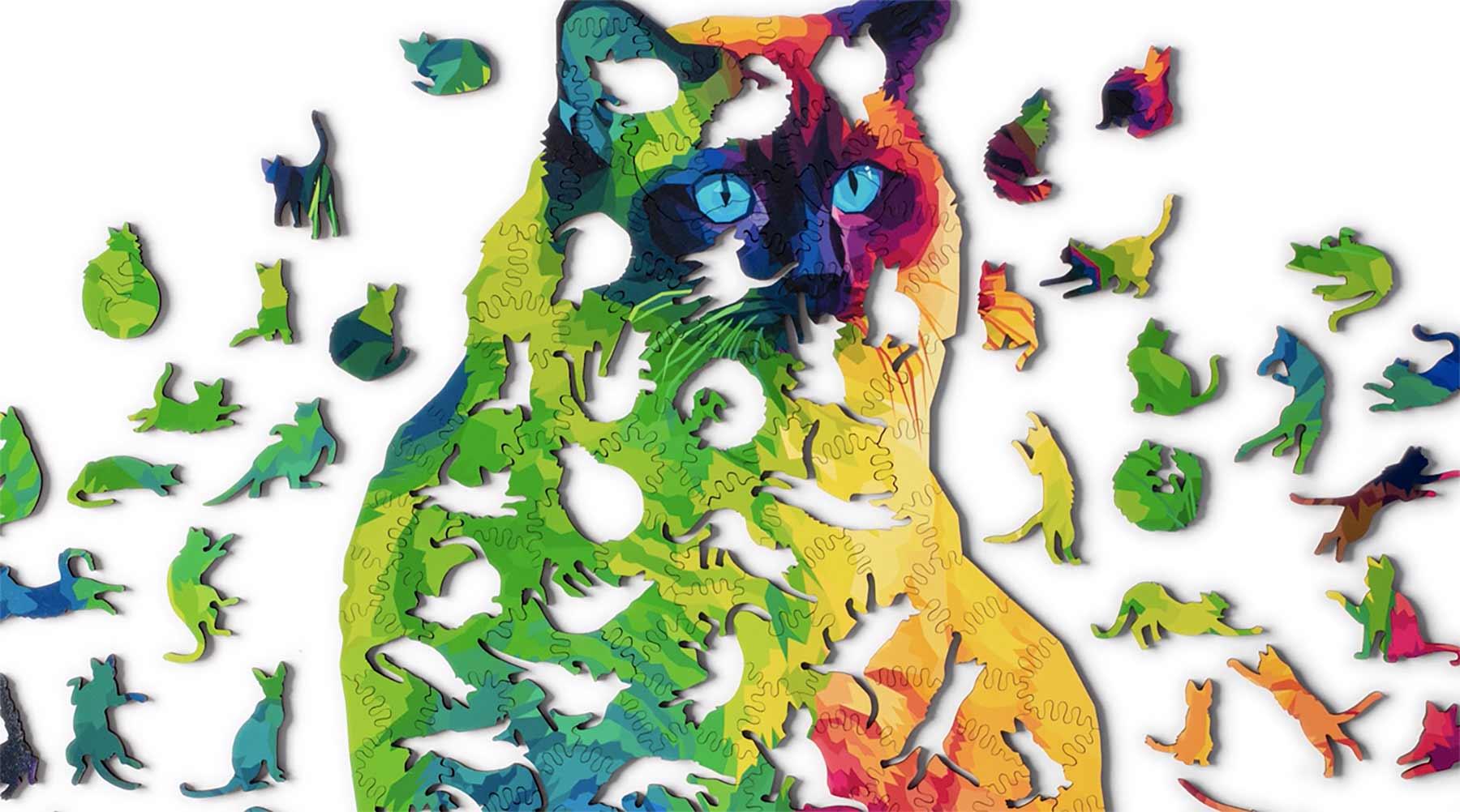 Puzzle aus vielen kleinen Katzenstücken ergibt eine große Katze