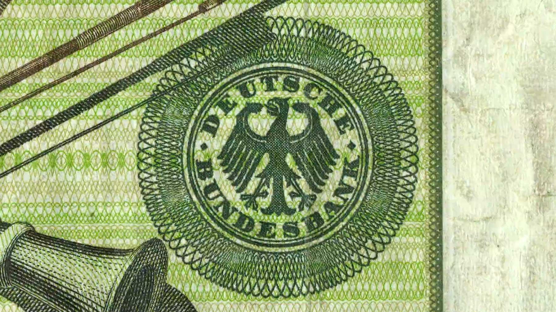 """Geldschein-Stopmotion: """"Money Is The One True God"""""""